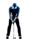 Man golfer golfing putting silhouette one in studio isolated on white background Stock Photo