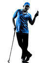 Man golfer golfing silhouette one in studio isolated on white background Royalty Free Stock Photography