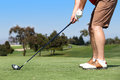 Man golfing playing a game of golf outside Stock Images