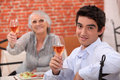 Man and grandmother in restaurant Royalty Free Stock Photo