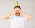 Man with green apple on his head screaming young Stock Image