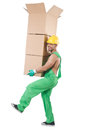 Man in green coveralls with boxes Stock Photo