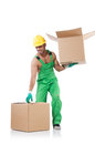 Man in green coveralls with boxes Royalty Free Stock Image