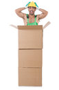 Man in green coveralls with boxes Stock Photography