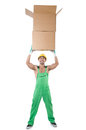 Man in green coveralls with boxes Stock Image