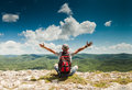 Man greeting nature on the top of mountain amazing rich Royalty Free Stock Image