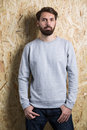 Man grey sweatshirt in on textured light brown background mock up Stock Image
