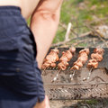 Man grilling shish kebab Stock Photography