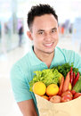 Man with a grocery bag Royalty Free Stock Photo