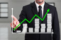 Man with growth chart business diagram on digital screen Royalty Free Stock Photo