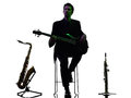 Man guitarist bassist  player playing silhouette Royalty Free Stock Photo