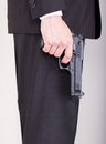 Man with gun, business suit Stock Photography