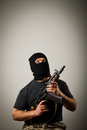 Man with gun in mask Stock Photos
