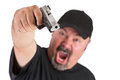 Man with the gun screams big goatee points his to you a loud scream make sure do whatever he says stop thinking focus on isolated Royalty Free Stock Images