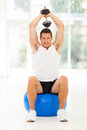 Man gym exercising muscular young at the with dumbbell Stock Photo