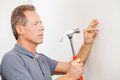 Man hammering a nail confident mature grey hair Stock Photography