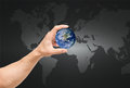 Man hand catching the earth on world map,Elements of this image Royalty Free Stock Photo