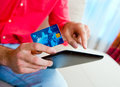 Man hand credit card and tablet Royalty Free Stock Photo