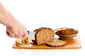 Man hand cutting bread isolated on white background Royalty Free Stock Photo