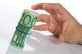 Man hand grabbing roll euro bills Stock Photo
