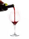 Man Hand holding Bottle filling Glass with Red Wine Royalty Free Stock Photo