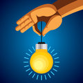 Man hand holding colorful bright incandescent light bulb Royalty Free Stock Photos
