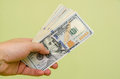 man hand holding money dollars Royalty Free Stock Photo