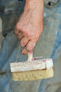 Man hand holding Paint Brush  grey background Royalty Free Stock Photo