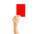 Man hand holding red card isolated on white for sport concept Royalty Free Stock Images