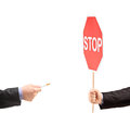 Man hand holding a stop sign and refusing a cigarette isolated on white background Royalty Free Stock Image