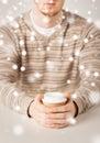 Man hand holding take away coffee cup