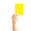 Man hand holding yellow card isolated on white for sport concept Stock Image