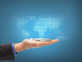 Man hand with smartphone and virtual world map Royalty Free Stock Photo