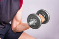 Man hand training lifting dumbbell strong bodybuilding. Royalty Free Stock Photo