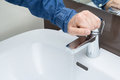 Man hand on water tap Royalty Free Stock Photo