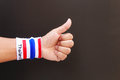 Man hand with wristband which thailand flag colors Royalty Free Stock Photo
