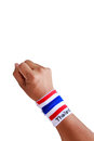 Man hand with wristband which thailand flag colors Stock Images