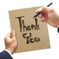 Man hand writing thank you on the paper his Royalty Free Stock Photos