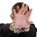 Man handcuffs closes hands face Stock Photos