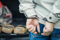 A man in handcuffs detained the transportation of drugs. Crime.