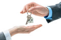 Man is handing a house key to other hands concept of real estate and deal Stock Photos