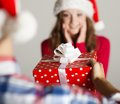 Man handing woman gift red wrapped to a beautiful Stock Photo