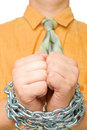 Man hands in chain, orange shirt and green tie Stock Image