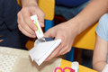 Man hands glue paper crafts at school desk Royalty Free Stock Photo