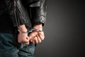 Man hands in handcuffs Royalty Free Stock Photo