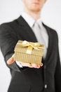Man hands holding gift box close up of Royalty Free Stock Images