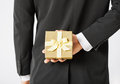Man hands holding gift box close up of Stock Photography