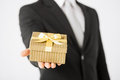 Man hands holding gift box close up of Stock Image
