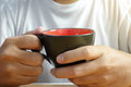 Man hands holding hot cup of coffee or tea Royalty Free Stock Photo