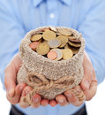 Man hands holding money bag with euro coins Stock Photos